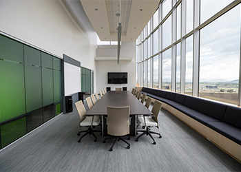 An office meeting room in need of commercial cleaning service.